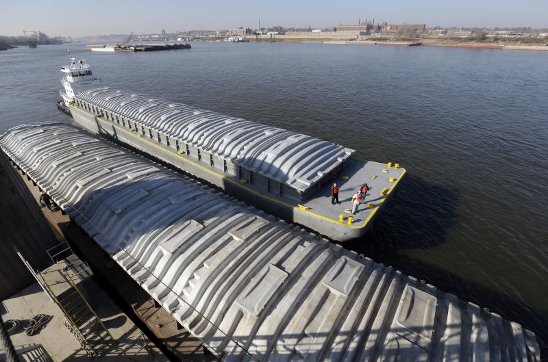 An empty barge, top, pulls along side a barge filled with soybeans as they prepare to switch places at an Archer Daniels Midland grain river terminal along the Mississippi River Wednesday, Nov. 28, 2012, in Sauget, Ill. The potential closure of the river due to low water levels has raised concern for barge companies and others who use the river for shipping with a prolonged shutdown of the river possibly costing billions of dollars in losses. (AP Photo/Jeff Roberson)