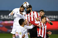 Real Madrid's Sergio Ramos, top left, goes for a header with Athletic Bilbao's Mikel Balenziaga during the Spanish Super Cup semi final soccer match between Real Madrid and Athletic Bilbao at La Rosaleda stadium in Malaga, Spain, Thursday, Jan. 14, 2021. Athletic Bilbao won 2-1 and will play the final. (AP Photo/Jose Breton)