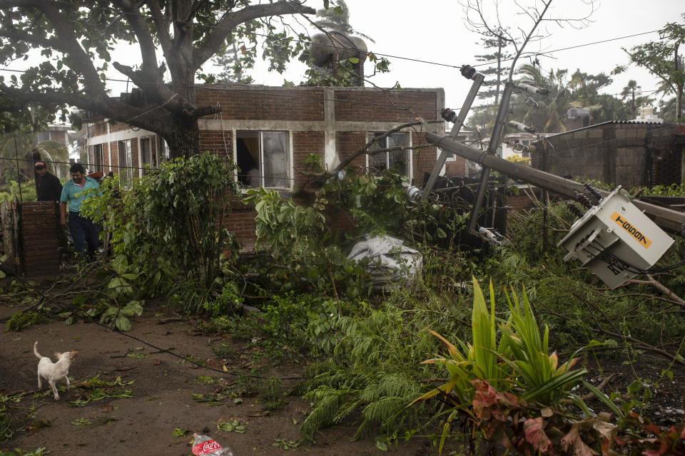 A man inspects the damage on his property in the aftermath of Hurricane Grace, in Tecolutla, Veracruz State, Mexico, Saturday, Aug. 21, 2021. Grace hit Mexico's Gulf shore as a major Category 3 storm before weakening on Saturday, drenching coastal and inland areas in its second landfall in the country in two days. (AP Photo/Felix Marquez)