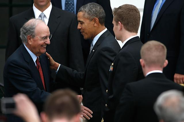 WASHINGTON, DC - APRIL 01: U.S. President Barack Obama (2nd L) greets former U.S. Sen. George Mitchell (L) (D-ME) during a ceremony on the South Lawn of the White House to honor the 2013 World Series Champion Boston Red Sox April 1, 2014 in Washington, DC. The Red Sox defeated the St. Louis Cardinals in the 2013 World Series. (Photo by Win McNamee/Getty Images)