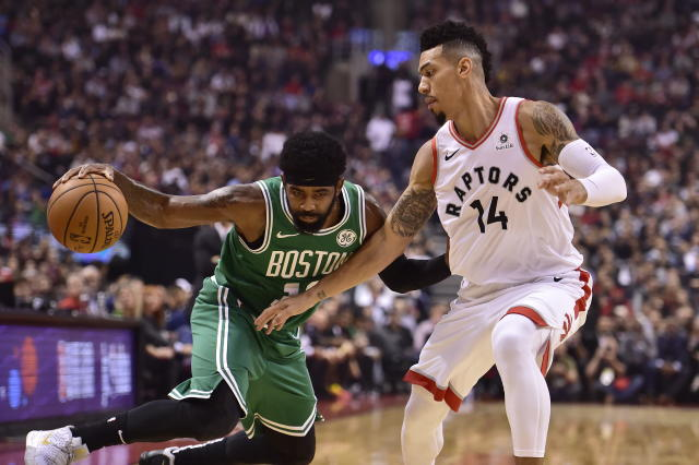 Boston Celtics guard Kyrie Irving (11) controls the ball as Toronto Raptors guard Danny Green (14) defends during the first half of an NBA basketball game, Friday, Oct. 19, 2018 in Toronto. (Frank Gunn/The Canadian Press via AP)