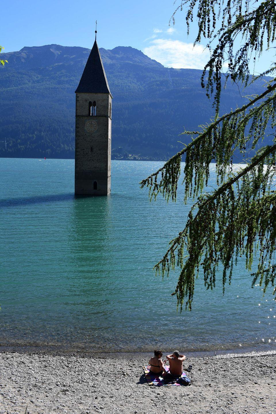 <p>Tourists marvel at the otherworldly scene of the church clock tower over 20 feet above the surface of the water. </p>