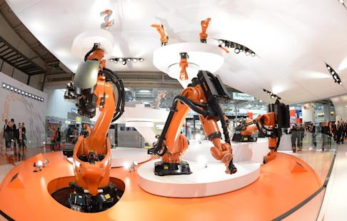 Kuka's industrial robots at the Hannover Messe in Germany on 8April 2013. Midea bought Kuka in 2016. Photo: DPA