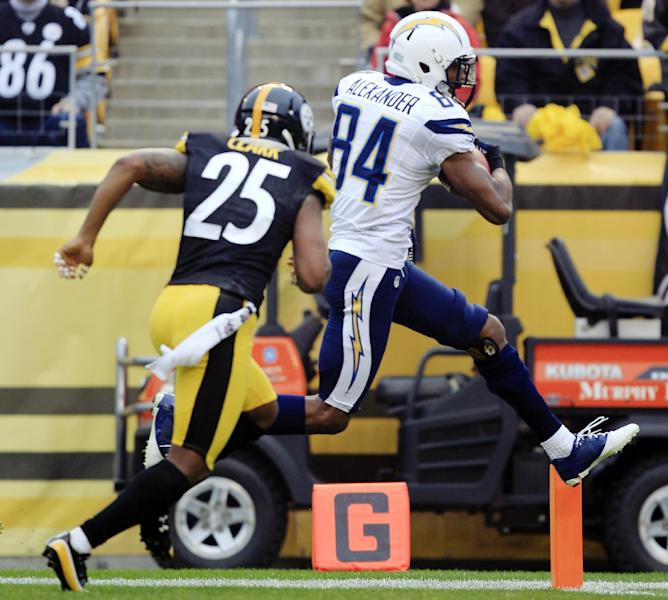 San Diego Chargers wide receiver Danario Alexander (84) leaps for the end zone to score a touchdown past Pittsburgh Steelers free safety Ryan Clark (25) after making a catch in the second quarter of an NFL football game in Pittsburgh, Sunday, Dec. 9, 2012. (AP Photo/Gene J. Puskar)