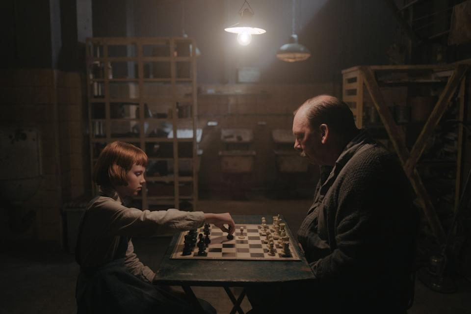 "Isla Johnston and Bill Camp play chess in ""The Queen's Gambit."""