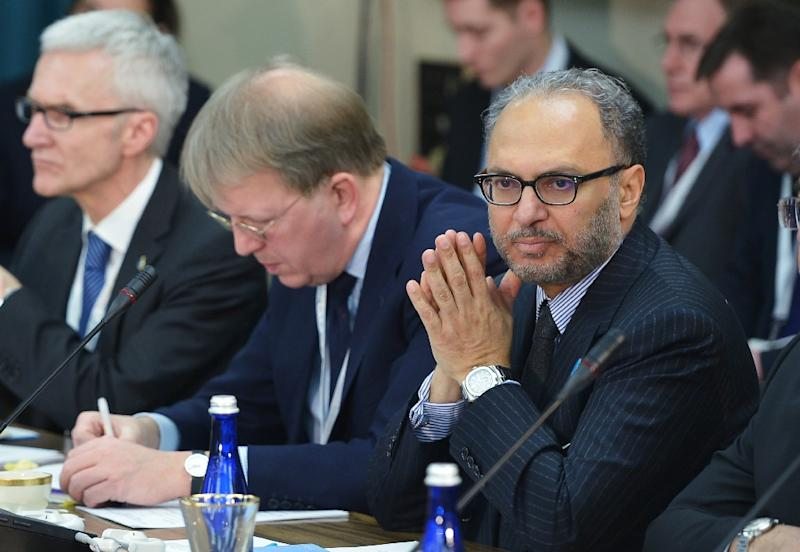 """United Arab Emirates Minister of State for Foreign Affairs Anwar Gargash, pictured (R) in February 18 2015, said November 30 that """"regional countries must bear part of the burden"""" of combating Islamic State jihadists in Syria (AFP Photo/Mandel Ngan)"""