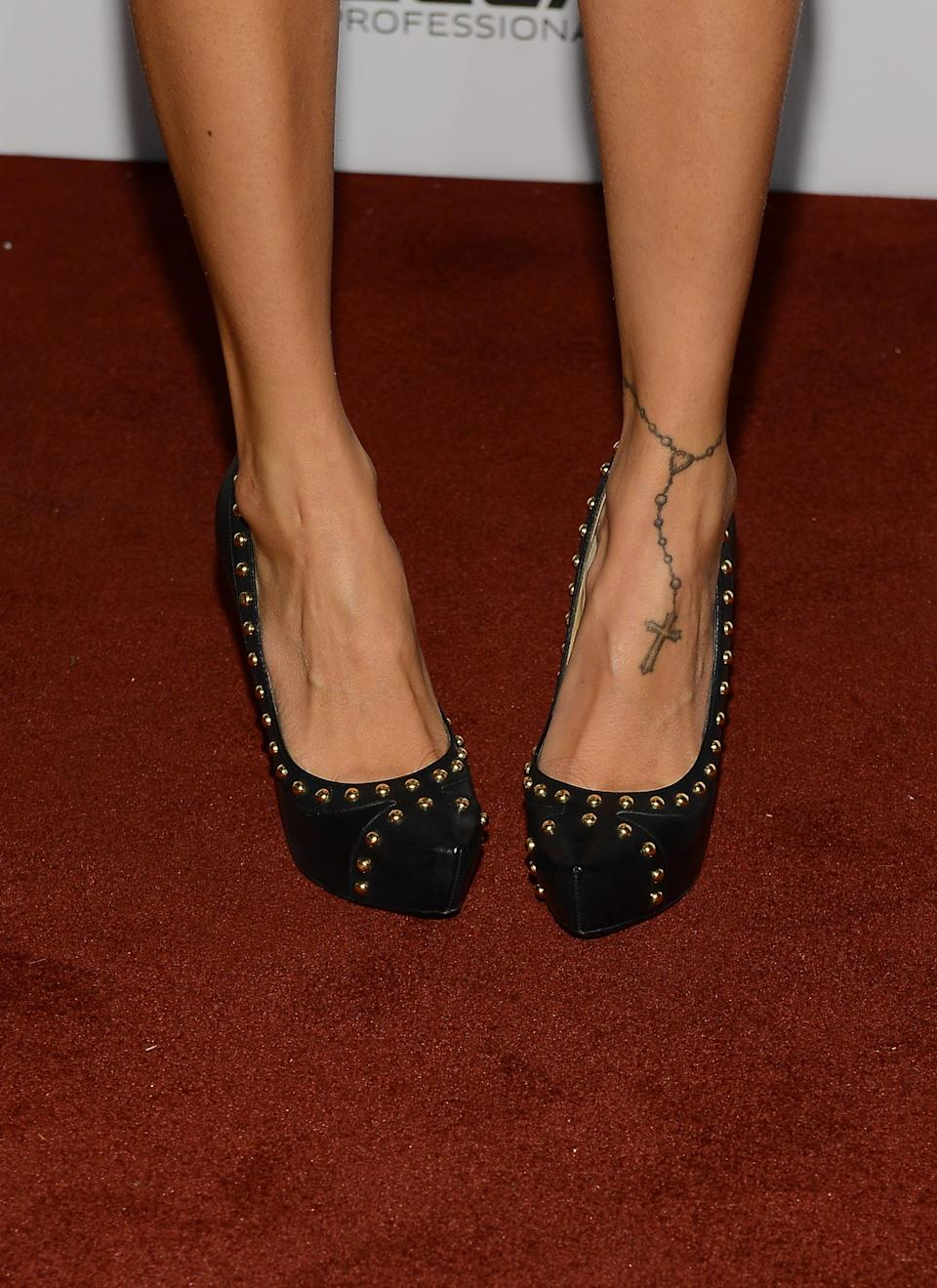 <b>Nicole Richie</b> may want her tramp stamp removed as soon as possible, but she has a soft spot for the rosary on her ankle. It's a fabulous way to accessorize an already fabulous pair of shoes, if you ask us!