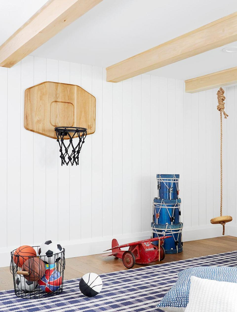 <p>Yes, even a basketball hoop can be chic. In this playroom designed by Emily Henderson, the swing, drums, and basketball hoops were customized to fit in with the contemporary home. And it's built to scale for the kids who use the space. </p>