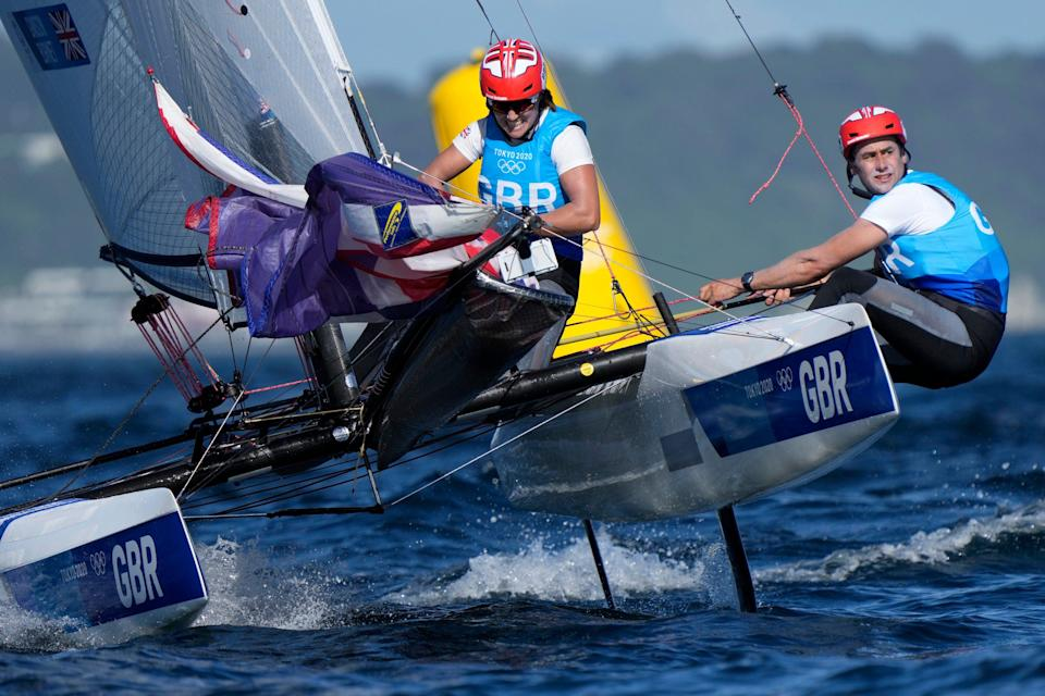 Great Britain's Anna Burnet and John Gimson compete during the mixed Nacra 17 medal race at the 2020 (AP Photo/Bernat Armangue)