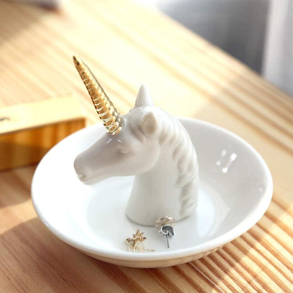 <p>Keep all your jewerly in this <span>Pudding Cabin Unicorn Ring Holder Dish</span> ($17).</p>
