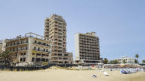 FAMAGUSTA , CYPRUS - JULY 11: Abandoned hotel buildings stand next to public beach inside the 'Forbidden Zone' of Varosha district on July 11, 2017 in Famagusta, Cyprus. Abandoned and decaying Buildings of the empty city of Famagusta ghost town.The abandoned quarter of Varosha was once a prime Cypriot resort. The Turkish military in the 1974 war has sealed off since Varosha residents fled after Turkey invaded Cyprus. Cyprus is a member of the European Union and north the self-proclaimed Turkish Republic of North Cyprus is recognized only by Turkey. (Photo by Athanasios Gioumpasis/Getty Images)