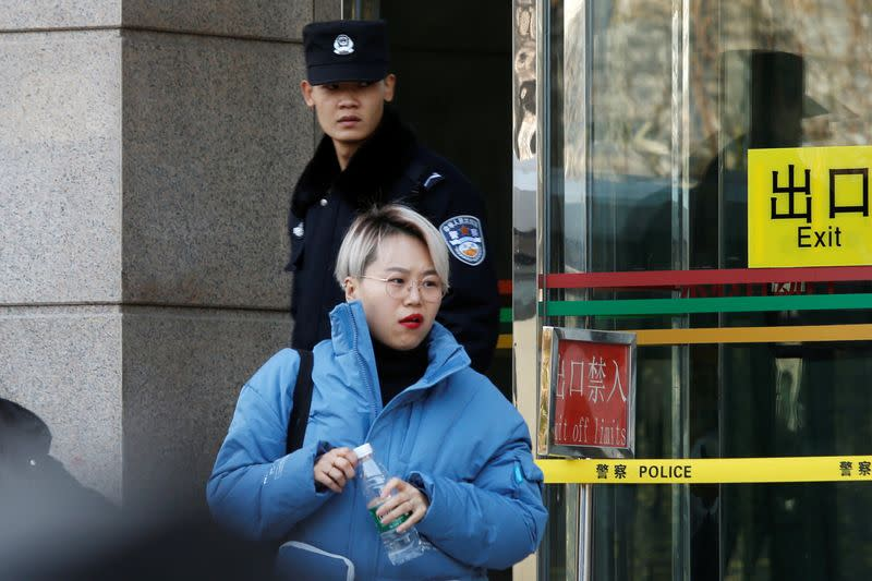 Teresa Xu leaves the Chaoyang People's Court after a court hearing in Beijing
