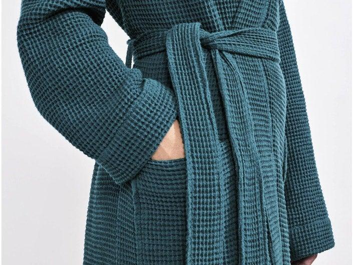 """<h3>Coyuchi Organic Waffle Robe</h3><br>Soft colors, 100% organic cotton, and a breathable waffle weave come together in perfect cozy harmony to create this classic spa-style robe that's pre-tumbled for optimal softness.<br> <br>Comforted reviewers claim everything from, """"This robe feels like a soft towel. So perfect now that it is getting cold,"""" to """"I was very happy with the quality of this robe! Lightweight but warm and so comfortable feels like being at a spa, I would recommend this for sure!"""" <br><br><strong>Coyuchi</strong> Unisex Organic Waffle Robe, $, available at <a href=""""https://go.skimresources.com/?id=30283X879131&url=https%3A%2F%2Fwww.coyuchi.com%2Funisex-waffle-robe.html"""" rel=""""nofollow noopener"""" target=""""_blank"""" data-ylk=""""slk:Coyuchi"""" class=""""link rapid-noclick-resp"""">Coyuchi</a>"""