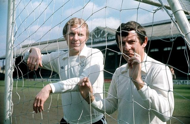 Alan Mullery with Bobby Moore at Fulham's Craven Cottage ground in 1975 (PA)
