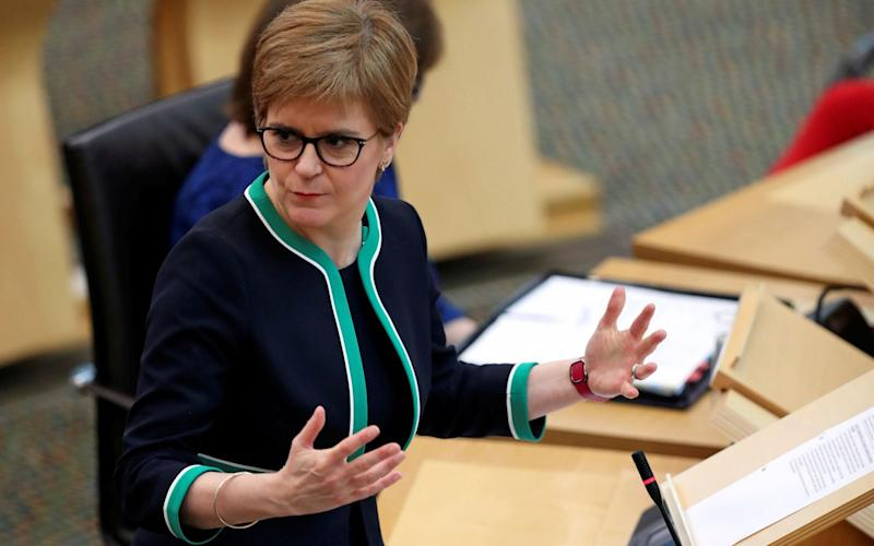 Nicola Sturgeon has previously used to impending publication of the report to avoid answering questions over the practice - RUSSELL CHEYNE/AFP