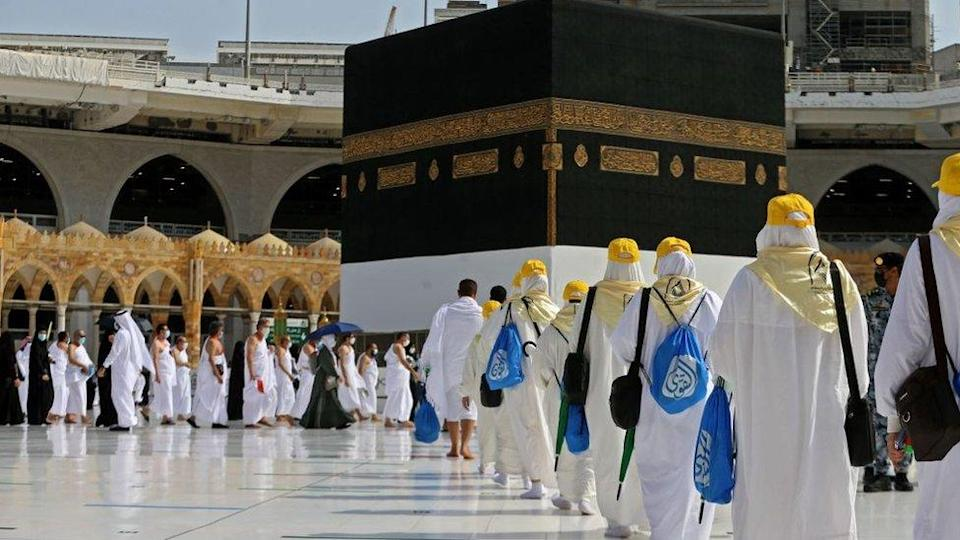 Pilgrims arrive at the Kaaba, Islam`s holiest shrine, at the Grand mosque in the holy city of Meccca