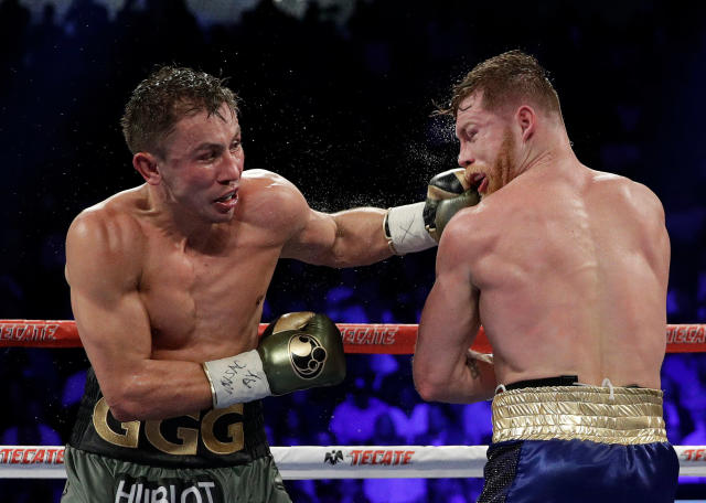 FILE - In this Sept. 17, 2017 file photo shows Gennady Golovkin, left, connects with a left to Canelo Alvarez during a middleweight title fight in Las Vegas. Golovkin is growing frustrated with boxing's sanctioning bodies while he struggles to find a replacement opponent for Canelo Alvarez on May 5. The unbeaten middleweight champion's rematch with Alvarez in Las Vegas fell through after the Mexican star failed a doping test in February and finally withdrew from the bout last week.(AP Photo/John Locher, File)