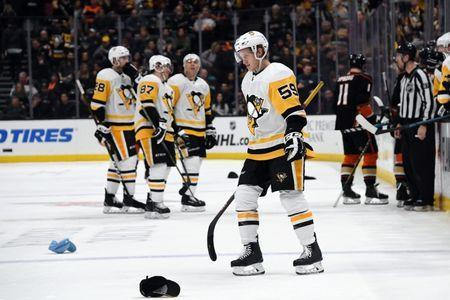 Jan 11, 2019; Anaheim, CA, USA; Pittsburgh Penguins left wing Jake Guentzel (59) reacts after scoring his third goal for a hat trick against the Anaheim Ducks in the third period at the Honda Center. The Penguins defeated the Ducks 7-4. Mandatory Credit: Kirby Lee-USA TODAY Sports