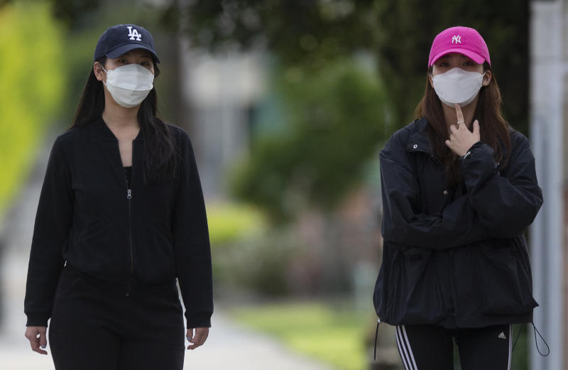 People wearing face masks in L.A.'s Chinatown
