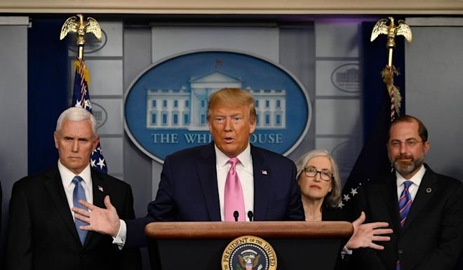 US President Donald Trump, flanked by Health and Human Services Secretary Alex Azar, US Vice-President Mike Pence (L) and CDC Principal Deputy Director Anne Schuchat, holds a news conference with members of the Centers for Disease Control and Prevention(CDC) on the COVID-19 outbreak at the White House on Wednesday. Photo: AFP
