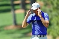 Johnson's back injury adds to Masters drama