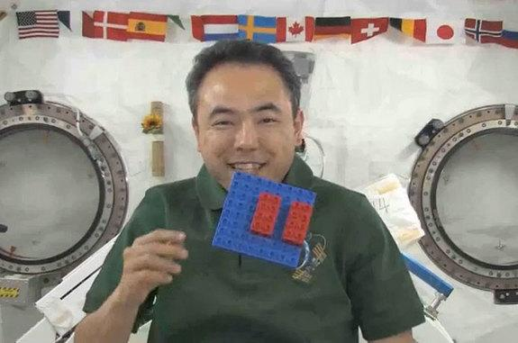 Japanese astronaut Satoshi Furukawa floats with LEGO (DUPLO) bricks aboard the International Space Station in 2011. The toys are now set to come home to Earth in March 2013.