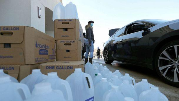PHOTO: Volunteers prepare to hand out water during a water distribution event at the Fountain Life Center on Feb. 20, 2021 in Houston, Texas. (Justin Sullivan/Getty Images)