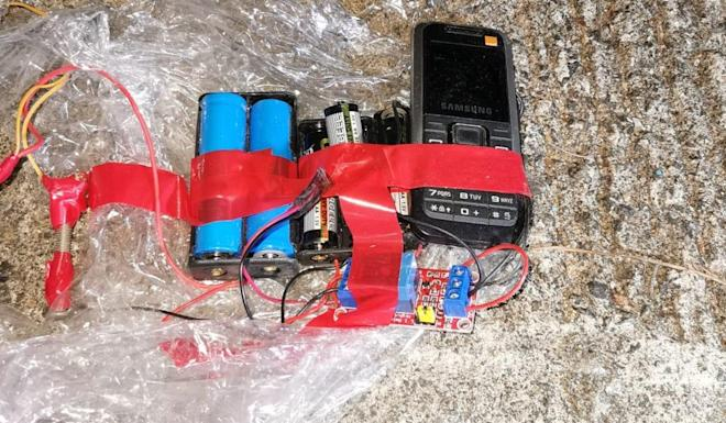A mobile phone would be used to detonate the device. Photo: Handout