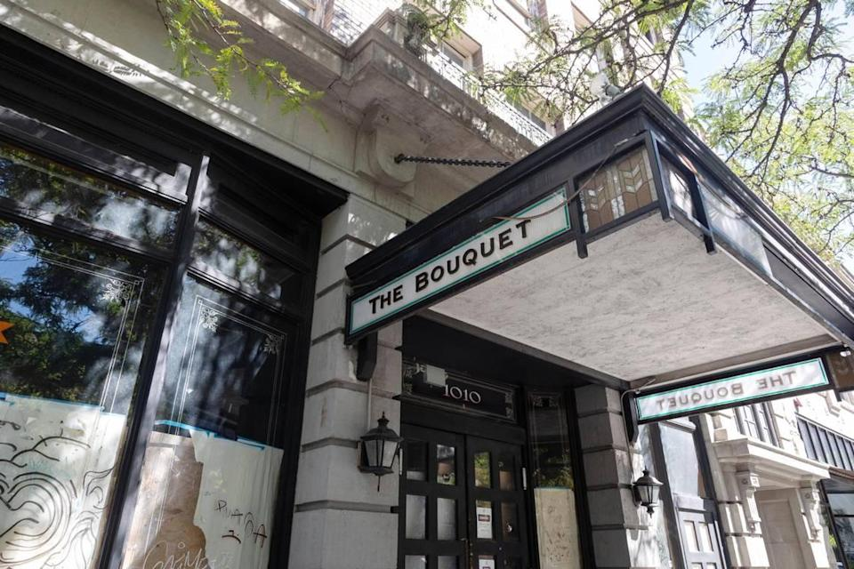 """The Bouquet sign still adorns the building entrance. Though it was not always located in the Averyl, The Bouquet has a long history of its own. It originally opened at 711 Main St. in 1902 and was """"a rough-and-tumble place with card games and call girls and frequent fisticuffs,"""" according to a 1994 article on the history of the Blues Bouquet."""