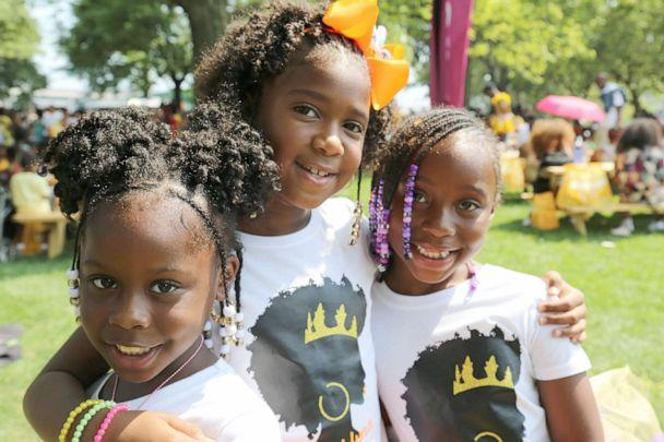 PHOTO: Curl friends: Journey Lee, Brooklyn Riley and Jae Baker at CURLFEST. (Marquis Hughes/ABC)
