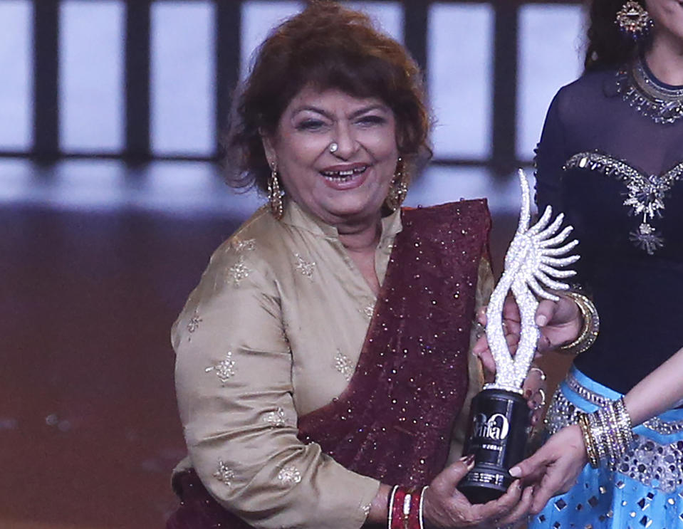 The legendary choreographer passed away of a cardiac arrest on July 3, this year. 71-year-old Saroj Khan, who suffered from diabetes and other age-related ailments, had been admitted to the hospital on June 20 due to breathing issues. <br><br>Known for her collaborations with Sridevi and Madhuri Dixit, across her more than four-decade-long career, Khan choreographed many iconic dance numbers such as Dola Re, Dhak Dhak Karne Laga and Tamma Tamma, among others. She is known as the first woman choreographer in Bollywood. <br><br><em><strong>Image credit: </strong></em>In this Sept. 19, 2019, file photo, Indian choreographer Saroj Khan is presented a special award during the 20th International Indian Film Academy (IIFA) awards ceremony in Mumbai, India. (AP Photo/Rafiq Maqbool, File)