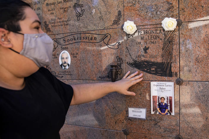 Kenia Leon touches the marker where her mother's ashes are interred in Las Vegas. (Joe Buglewicz / for NBC News)