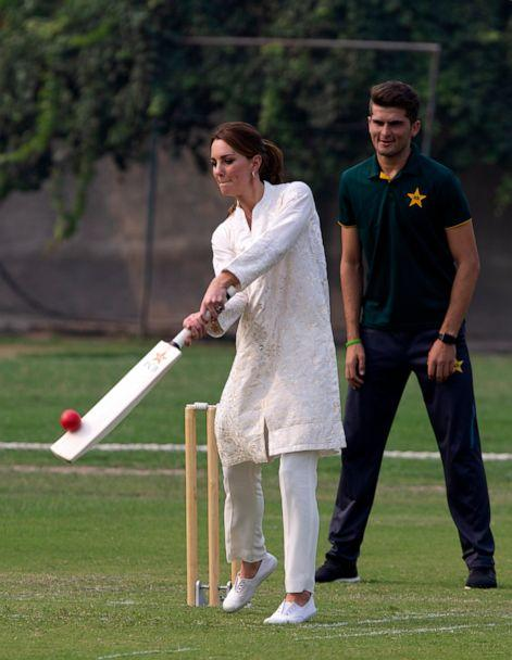 PHOTO: Catherine, Duchess of Cambridge, bats as Pakistani cricketer Shaheen Afridi looks on during her visit to the Pakistan Cricket Academy in Lahore, Pakistan, Oct. 17, 2019. (B.K. Bangash/AP)