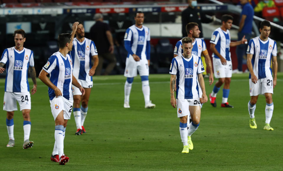 Espanyol's players during the Spanish La Liga soccer match between FC Barcelona and RCD Espanyol at the Camp Nou stadium in Barcelona, Spain, Wednesday, July 8, 2020. (AP Photo/Joan Monfort)