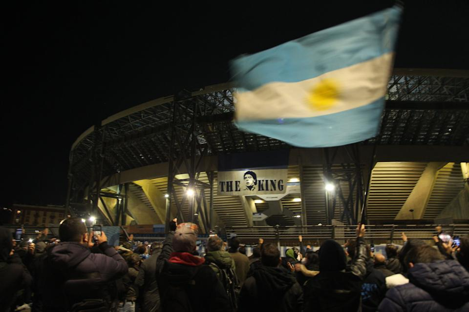 <p>Fans have gathered outside the stadium to pay their respects</p>AFP via Getty Images