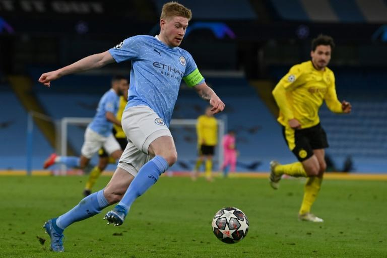 Leading from the front: Manchester City captain Kevin De Bruyne (left)scored the opening goal against Borussia Dortmund