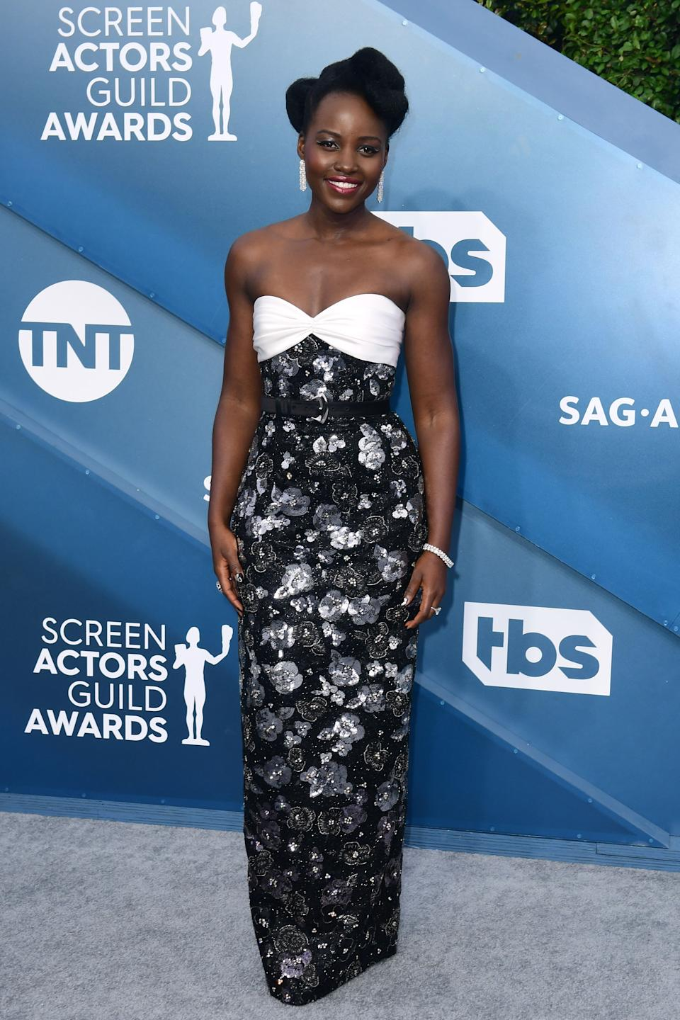 """<h2>Lupita Nyong'o in Louis Vuitton</h2><br>Honestly, <em>Us</em> star Lupita Nyong'o could show up on the red carpet wearing sweatpants and we'd praise her. Then again, we wouldn't trade this belted, floral frock for anything. <br><br><span class=""""copyright"""">Photo by FREDERIC J. BROWN/AFP via Getty Images.</span>"""