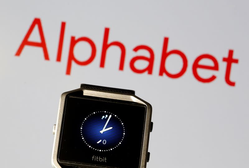 Fitbit Blaze watch is seen in front of a displayed Alphabet logo in this illustration