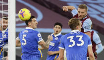 West Ham's Tomas Soucek, right, scores his side's second goal during the English Premier League soccer match between West Ham and Brighton in London, England, Sunday, Dec. 27, 2020. (AP Photo/Kirsty Wigglesworth, Pool)