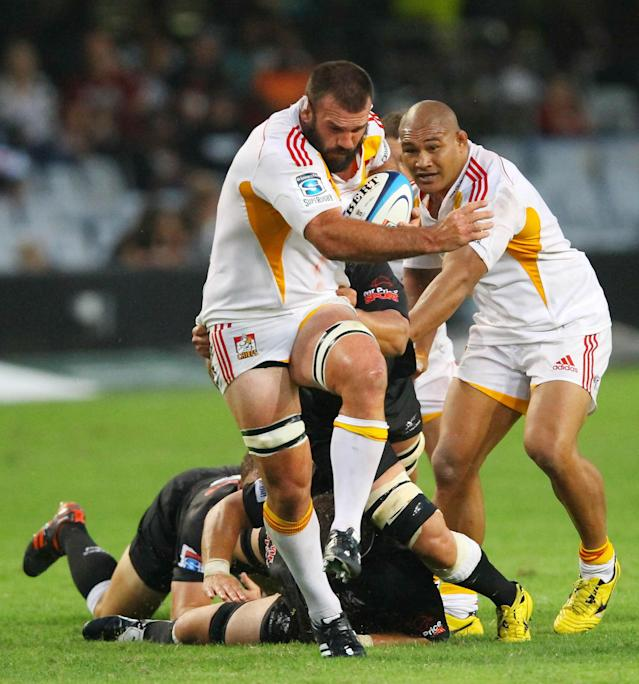 New Zealand Waikato Chiefs' Alex Bradley (C) breaks away from Durban Sharks' defence during a Super 15 rugby union match at the Mr Price Kings Park Rugby Stadium on April 21, 2012. AFP PHOTO (Photo credit should read -/AFP/Getty Images)