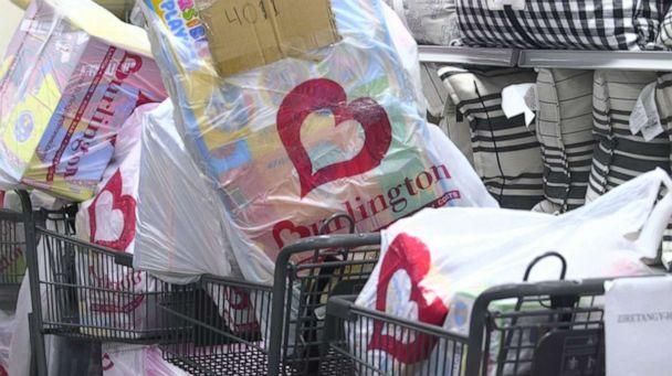 PHOTO: Carts filled with children's toys and clothes were wheeled out to surprise customers that they're layaway accounts were paid off at a Burlington Coat Factory in Harlem. (ABC News)