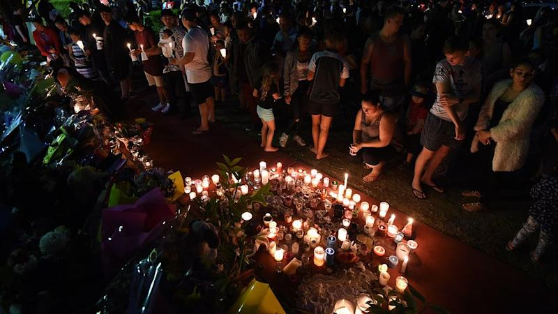 Mourners continue to leave floral tributes and host candle light vigils at the gates of Dreamworld. Photo: AAP