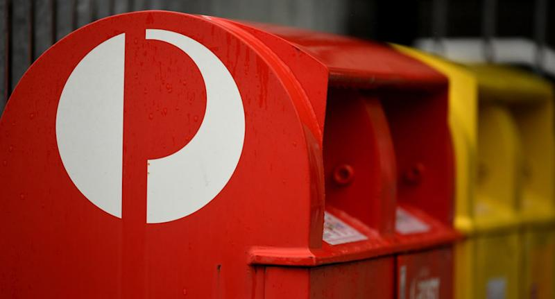 Two workers at an Australia Post parcel facility have tested positive for coronavirus. Source: AAP