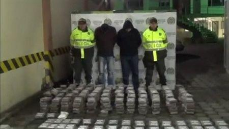 Police display seized drugs and two arrested suspects in Pasto, Colombia, November 8, 2015 in this still image taken from video. REUTERS/Colombian Police Handout via Reuters TV