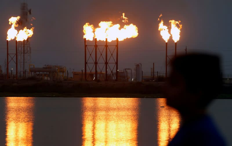 FILE PHOTO: Flames emerge from flare stacks at Nahr Bin Umar oilfield, north of Basra