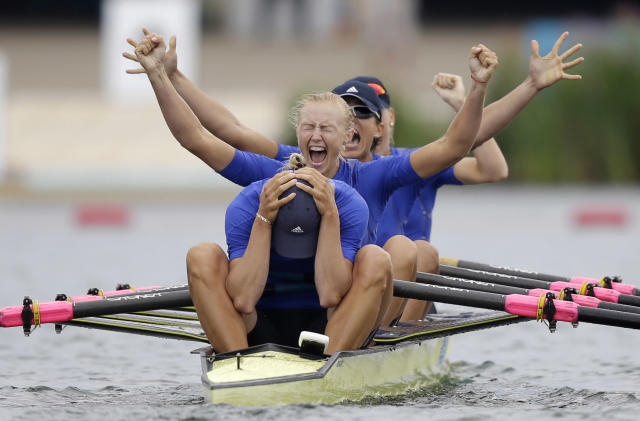 Yana Dementieva (front), Anastasiia Kozhenkova, Nataliya Dovgodko, and Kateryna Tarasenko of Ukraine celebrate after winning the women's quadruple sculls Final A at Eton Dorney during the London 2012 Olympic Games August 1, 2012. REUTERS/Natacha Pisarenko/Pool (BRITAIN)