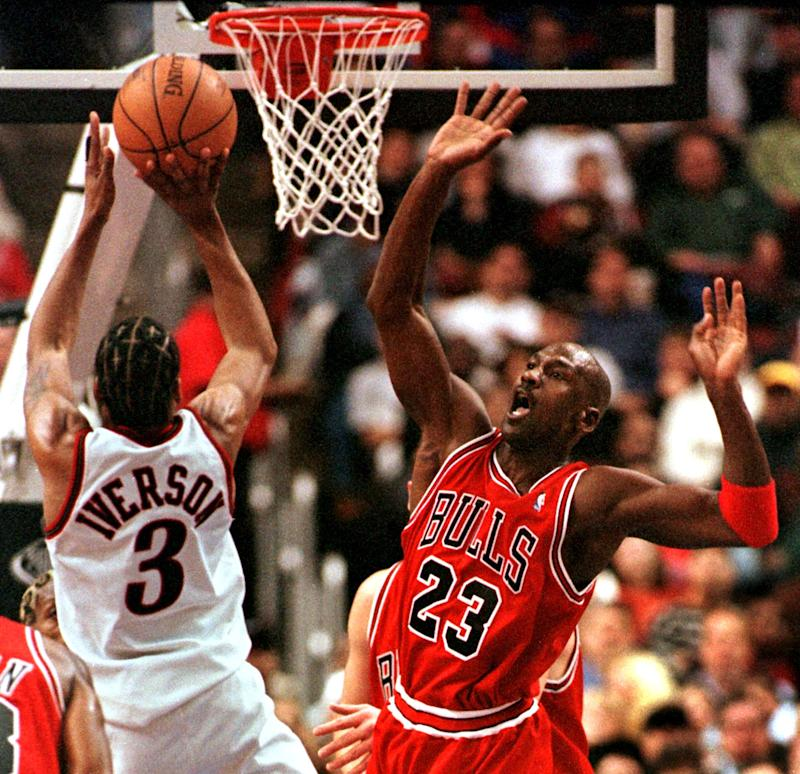 Chicago Bulls Michael Jordan (R) reacts as Philadelphia 76ers Allen Iverson goes up to the basket for two points in the game 15 January in Philadelphia, PA. Iverson's 31 points led the 76ers in their 106-96 upset of the world champion Bulls. AFP PHOTO TOM MIHALEK (Photo by TOM MIHALEK / AFP) (Photo by TOM MIHALEK/AFP via Getty Images)