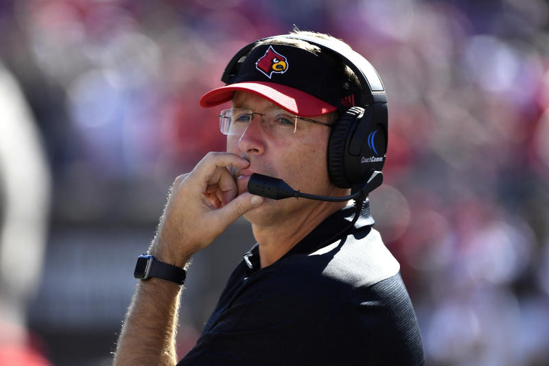 Louisville head coach Scott Satterfield watches the action during the second half of an NCAA college football game against Clemson in Louisville, Ky., Saturday, Oct. 19, 2019. Clemson won 45-10. (AP Photo/Timothy D. Easley)