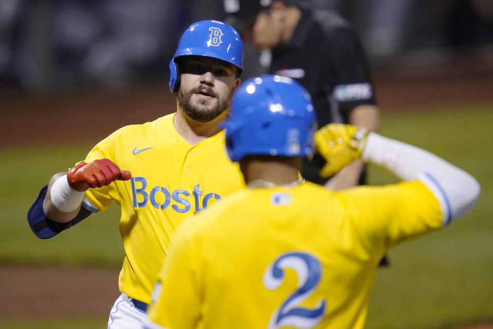 Boston Red Sox's Kyle Schwarber, left, is congratulated by Xander Bogaerts (2) after his solo home run off New York Mets starting pitcher Taijuan Walker during the first inning of a baseball game at Fenway Park, Wednesday, Sept. 22, 2021, in Boston. (AP Photo/Charles Krupa)