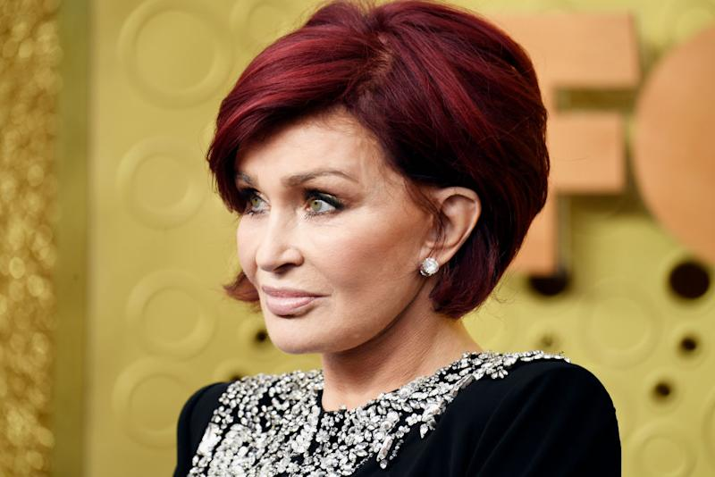 Sharon Osbourne with red hair on red carpet in 2019